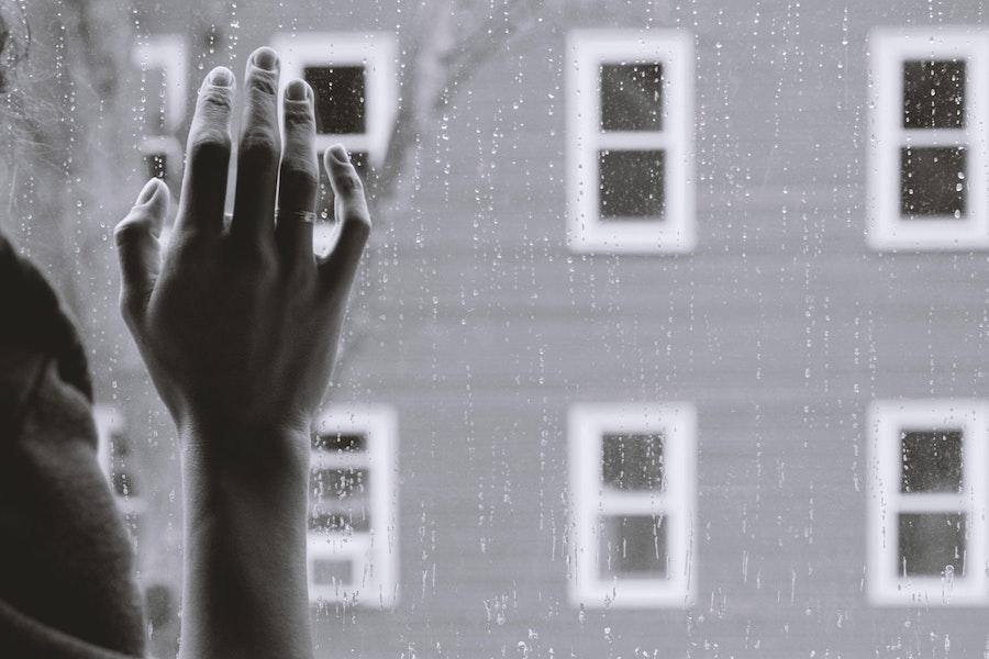 hand on window depressed